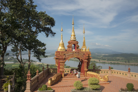 the temple WatThat Doi Pu Khao in the town of  Sop Ruak at the mekong river in the golden triangle in the north of the city Chiang Rai in North Thailand.