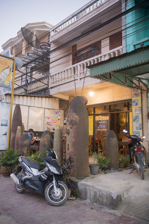 a Restaurant with old Bombs at the road of the town of Phonsavan in the province Xieng Khuang in north Lao in southeastasia.