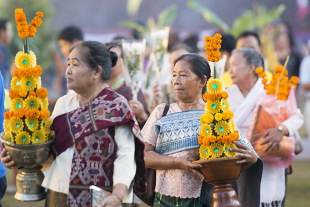 People at a ceremony at the Pha That Luang Festival in the city of vientiane in Laos in the southeastasia.