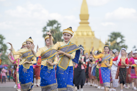 Traditional dress People at a ceremony at the Pha That Luang Festival in the city of vientiane in Laos in the southeastasia.