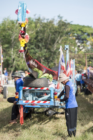 start preperations at the traditional Longboat Race at the Khlong Chakarai River in the Town of Phimai in the Provinz Nakhon Ratchasima in Isan in Thailand.  Thailand, Phimai, November, 2017