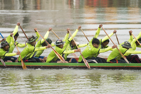 the tradititional Longboat Race at the Mun river of the town of Satuek north of the city Buri Ram in Isan in Northeast thailand.  Thailand, Buriram, November, 2017