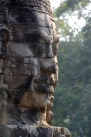 Stone face at the Bayon Temple the Tempel Ruins of Angkor Thom in the Temple City of Angkor near the City of Siem Reap in the west of Cambodia. Cambodia, Siem Reap, April 2014