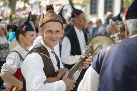 a traditonal madeira folklore music group s at the Festa da Flor or Spring Flower Festival in the city of Funchal on the Island of Madeira in the Atlantic Ocean of Portugal. Madeira, Funchal, April, 2018