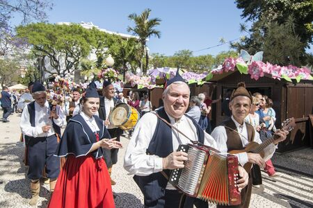 a traditonal madeira folklore music group s at the Festa da Flor or Spring Flower Festival in the city of Funchal on the Island of Madeira in the Atlantic Ocean of Portugal. Madeira, Funchal, April, 2018 Sajtókép