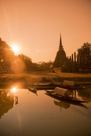 the landscape with the stupa at the Wat Sa Si Temple at the Historical Park in Sukhothai in the Provinz Sukhothai in Thailand. Thailand, Sukhothai, November, 2018