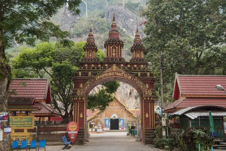 the Wat Tham Pla or monkey temple near the town of Mae Sai on the Border to Myanmar in the Chiang Rai Province in North Thailand.   Thailand, Mae Sai, November, 2019