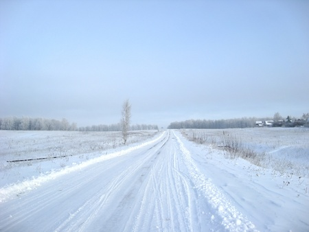 Snowly road in sunny day and nobody photo