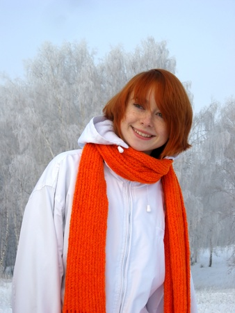Red-haired girl with orange scarf at winter day Stock Photo - 9427231