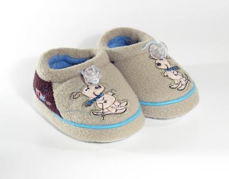 Grey little child shoes on white background photo