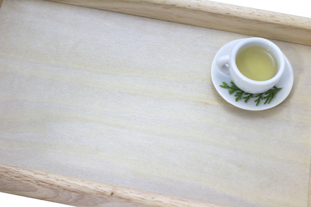 picture of cup of green tea on wood tray background photo