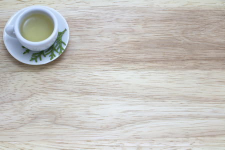 picture of cup of green tea on wood background photo
