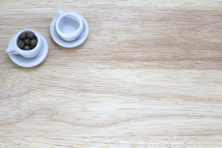 picture of two cups on wood background photo