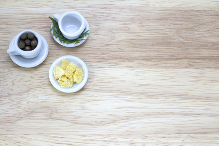 picture of two cups and snacks on wood background photo