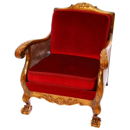 royals: Danish royal-red decorated armchair with rattan isolated on white background