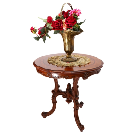 adorned: Golden adorned vase with roses on a small wooden coffee table isolated on white background Stock Photo