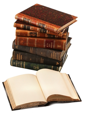 antique books: Some old books with opened book in the front isolated on white background