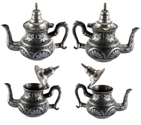 ewer: Decorated silver kettle (view from different angles) isolated on white background