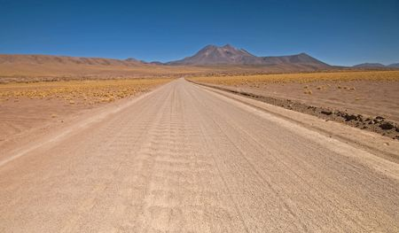 Desert road through San Pedro de Atacama in Chile Stock Photo