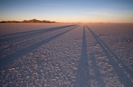 waterless: Sunrise casting magnificent shadows over the Bolivian Salt Flats. Stock Photo