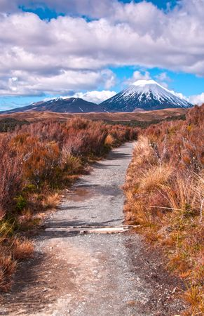 new path: Mt Ngaurohoe in Tongariro National Park, New Zealand. Iconic snow-capped mountain was used in the Lord of the Rings movies and is better known as Mount Doom.