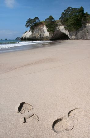 Footprints on Cathedral Cove beach on the coromandel peninsula, New Zealand  photo