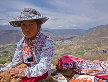 Colca Canyon, Peru, December 2009 - Young Peruvian girl selling local hand-made goods in the Colca Canyon.