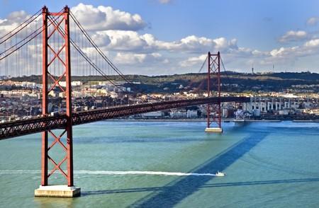suspension bridge: The 25th of April Suspension Bridge in Lisbon, Portugal. Stock Photo