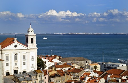 tagus: Alfama district and the Tagus River in Lisbon Stock Photo