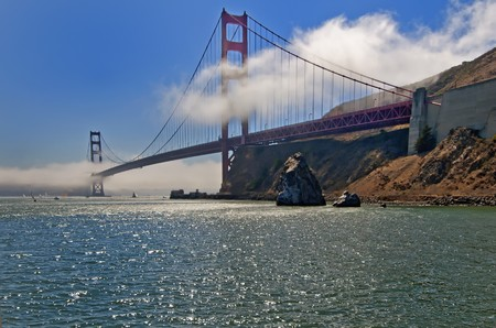 Morning mist clears over the Golden Gate Bridge in San Francisco, California, USA photo