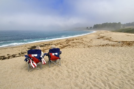 big sur: An elderly couple sit waiting for the mist to clear on the Big Sur, California Stock Photo