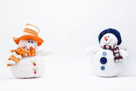 Two Christmas Snowmen on a white background.