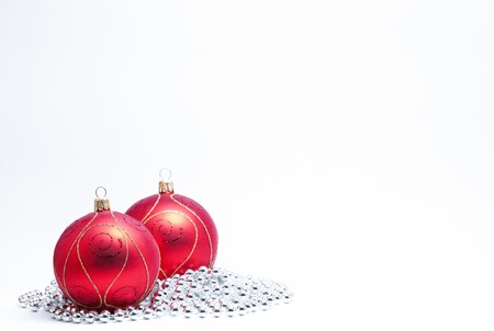 Red Christmas Baubles with gold glitter and silver beads on a white background. (Selective Focus) Stock Photo