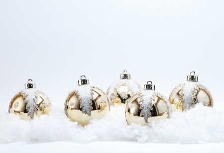 Gold Christmas Baubles (Selective Focus) with white glitter holly Leaf decoration on a white background. Stock Photo - 7598437