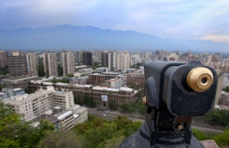 cerro: View of Santiago city with focus on coin opperated telescope