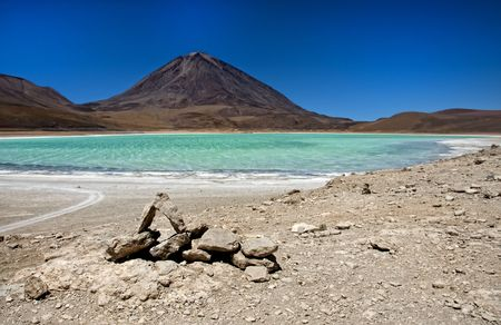 Laguna Verde in the Atacama Desert on the Bolivian side.  Stock Photo