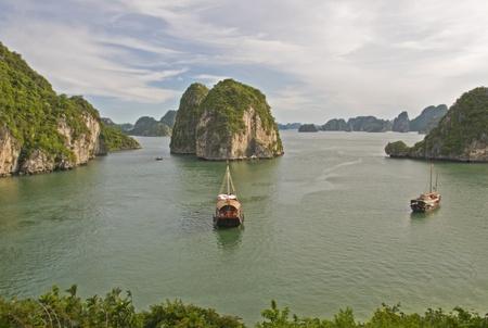 Tourist Junk Boats in Halong Bay, Vietnam photo