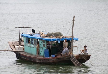 Fishing boat in Halong Bay, Vietnam, July 3 2010. A community of around 1,600 people live on Ha Long Bay in four fishing villages. They are sustained through fishing and marine aquaculture.