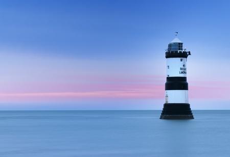 du ร    ก ร: Penmon (Trwyn Du) Lighthouse on the Isle of Angelsey, Wales. Stock Photo