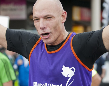 Premiership Football referee Howard Webb finishing the 2011 Buba Great Yorkshire 10km run in Sheffield, October 9th 2011. Stock Photo - 11241092