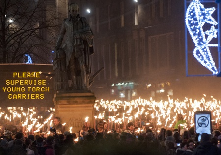 torchlight: People take part in a torchlight procession on December 30, 2011 in Edinburgh, Scotland. The torchlight procession is an annual event to celebrate the end of the year.