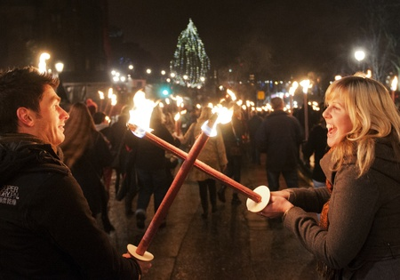 procession: Couple take part in a torchlight procession on December 30, 2011 in Edinburgh, Scotland. The torchlight procession is an annual event to celebrate the end of the year.