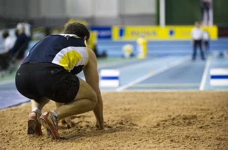 Ashley Bryant looks back for the white flag after jumping 6.86 in the men's long jump final during the Aviva Indoor UK Trials and Championships at the English Institute of Sport in Sheffield, England, February 11 2012. Stock Photo - 12255983