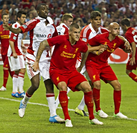 Liverpools Martin Skrtel (front left) and Jonjo Shelvey (front right) jostle for position during Liverpools first pre-season match of their North American tour against Toronto FC at the Rogers Centre in Toronto, Canada, July 21 2012.