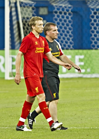lucas: Lucas Leiva (left) and Brendan Rodgers walk off the field after Liverpools first pre-season match of their North American tour against Toronto FC at the Rogers Centre in Toronto, Canada, July 21 2012.