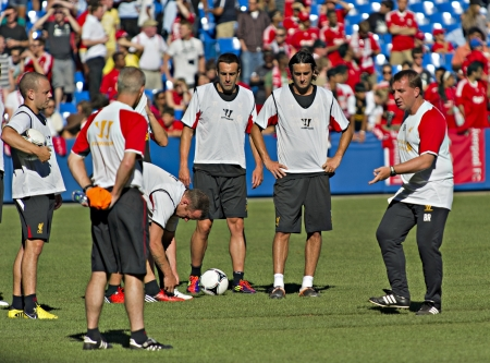 Liverpool manager Brendan Rodgers (right) gives out instructions during Liverpool FC training session prior to Liverpool's first pre-season match of their North American tour against Toronto FC at the Rogers Centre in Toronto, Canada, July 20 2012.