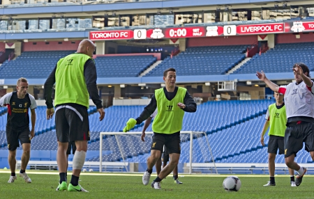 Alberto Aquilani (right) and Kristian Adorjan (centre) take part in Liverpool FC training session prior to Liverpool's first pre-season match of their North American tour against Toronto FC at the Rogers Centre in Toronto, Canada, July 20 2012.