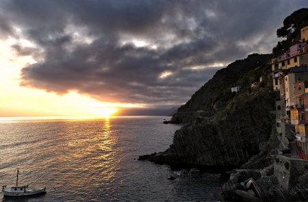 Sunset over the 13th century village of Riomaggiore in Cinque Terre, Italy. photo