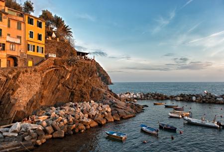 vernazza: Sunset over the 13th Century village of Riomaggiore in Cinque Terre, Italy.