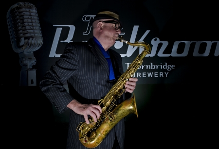 Musician Bob Swift playing the tenor saxophone during a gig at the Greystones with his four-piece rhythm & blues band  Stock Photo - 15318367